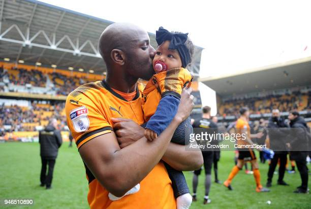 Wolverhampton Wanderers' Benik Afobe kisses his daughter at full time during the Sky Bet Championship match between Wolverhampton Wanderers and...