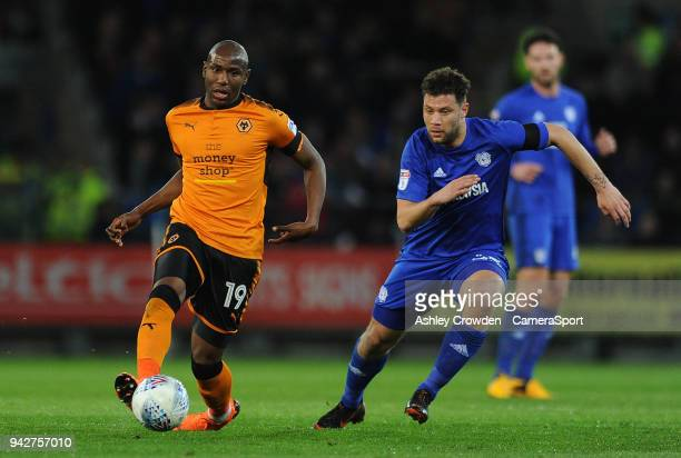 Wolverhampton Wanderers' Benik Afobe vies for possession with Cardiff City's Yanic Wildschut during the Sky Bet Championship match between Cardiff...