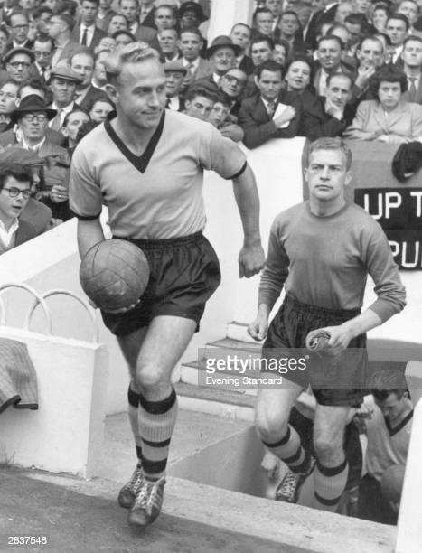 Wolverhampton Wanderers captain Billy Wright leads his team onto the pitch followed by goalkeeper Finlayson