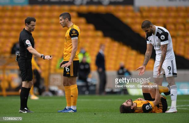 Wolverhampton Wanderers' Captain Conor Coady complains to referee Darren England after Fulham's Aleksandar Mitrovic tackle on Wolverhampton...