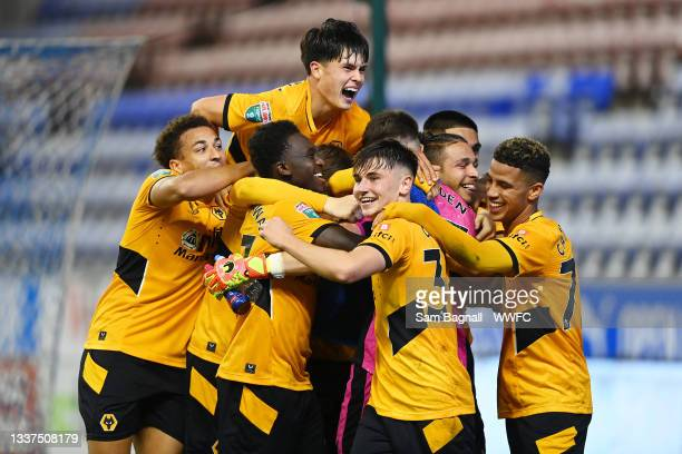 Wolverhampton Wanderers celebrate after winning the penalty shoot out during the Papa John's Trophy EFL Trophy match between Wigan Athletic and...