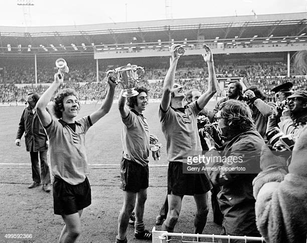 Wolverhampton Wanderers celebrate with the trophy after their victory in the League Cup Final against Manchester City at Wembley stadium in London...