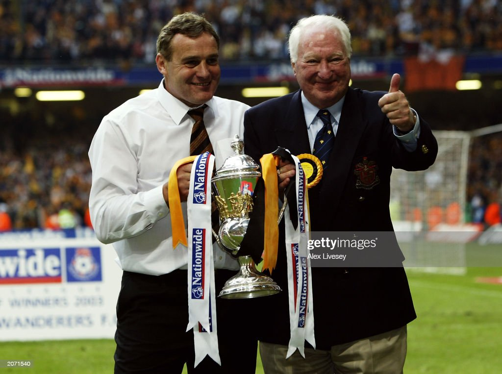 Wolverhampton Wanderers chairman Sir Jack Hayward and manager Dave Jones celebrate with trophy : News Photo