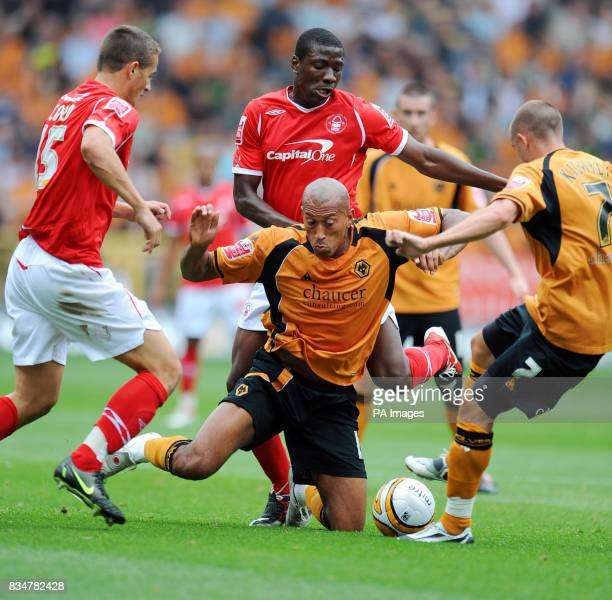 Wolverhampton Wanderers' Chris Iwelumo falls whilst challenged by Nottingham Forest's Chris Cohen and Guy Moussi during the CocaCola Championship...