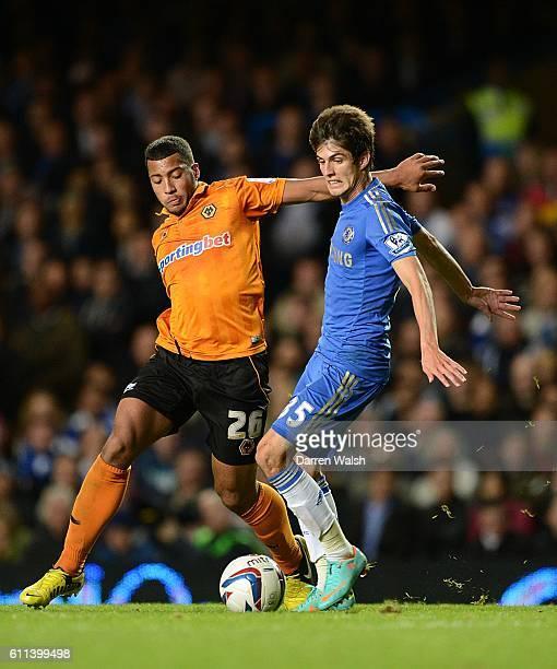 Wolverhampton Wanderers' David Davis and Chelsea's Lucas Piazon battle for the ball