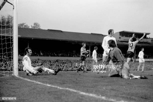 Wolverhampton Wanderers' Derek Dougan celebrates the opening goal to the dejection of Leeds United's Paul Reaney David Harvey and Paul Madeley