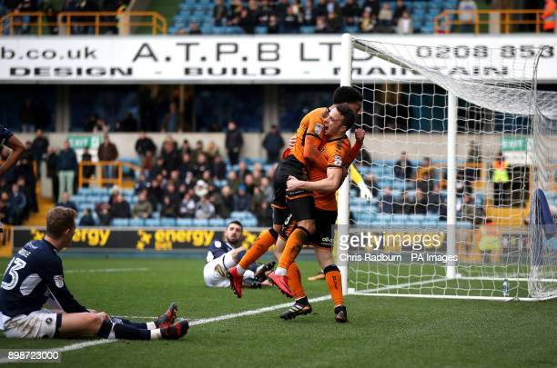Wolverhampton Wanderers Diogo Jota celebrates his with team mate Helder Costa goal l during the Sky Bet Championship match at The New Den London