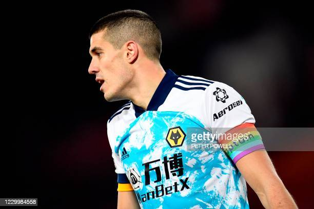 Wolverhampton Wanderers' English defender Conor Coady wears a rainbow captains armband during the English Premier League football match between...