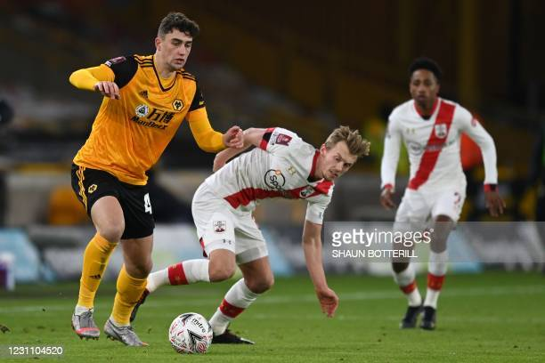 Wolverhampton Wanderers' English defender Max Kilman vies with Southampton's English midfielder James Ward-Prowse during the English FA Cup fifth...