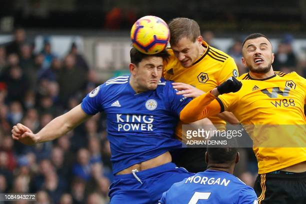 Wolverhampton Wanderers' English defender Ryan Bennett beats Leicester City's English defender Harry Maguire to the ball as his header makes the...