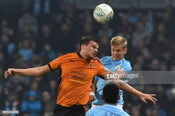Wolverhampton Wanderers' English defender Ryan Bennett vies with Manchester City's Ukrainian midfielder Oleksandr Zinchenko during the English League...