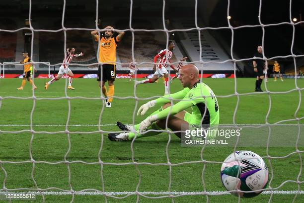 Wolverhampton Wanderers' English goalkeeper John Ruddy and Wolverhampton Wanderers' Portuguese midfielder Ruben Neves react to going behind during...
