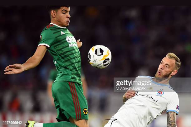 TOPSHOT Wolverhampton Wanderers' English midfielder Morgan GibbsWhite and Slovan's Dutch midfielder Joeri de Kamps vie for the ball during the UEFA...