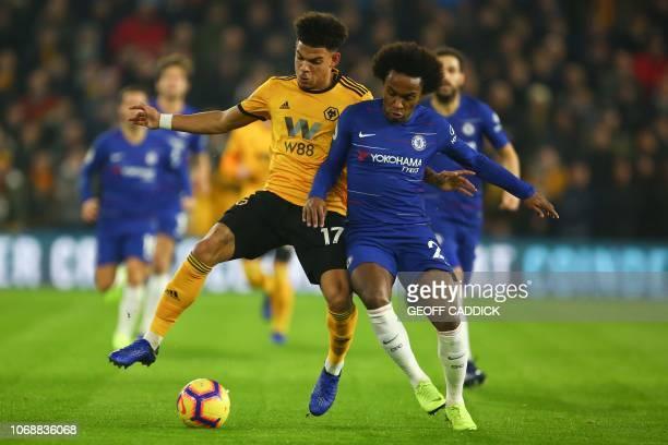 Wolverhampton Wanderers' English midfielder Morgan GibbsWhite challenges Chelsea's Brazilian midfielder Willian during the English Premier League...