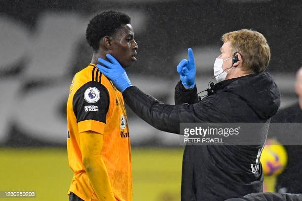 Wolverhampton Wanderers' English midfielder Owen Otasowie is checked over after a clash of heads during the English Premier League football match...