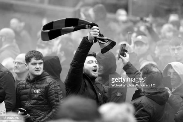 Wolverhampton Wanderers fans enjoy the atmosphere as they wait for the team bus to arrive ahead of the Premier League match between Wolverhampton...