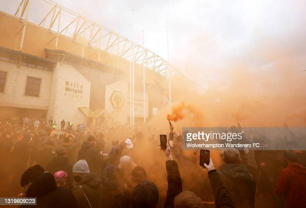 Wolverhampton Wanderers fans set off smoke flares as they wait for the team bus to arrive outside the stadium prior to the Premier League match...