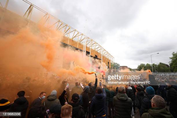 Wolverhampton Wanderers fans set off smoke flares as they wait for the team bus to arrive ahead of the Premier League match between Wolverhampton...