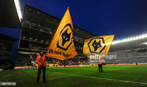 Wolverhampton Wanderers flag bearers wave their flags during the Sky Bet Championship match between Wolverhampton Wanderers and Newcastle United at...