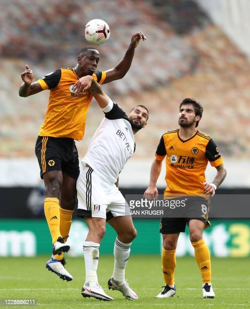 Wolverhampton Wanderers' French defender Willy Boly and Fulham's Serbian striker Aleksandar Mitrovic compete for the ball during the English Premier...