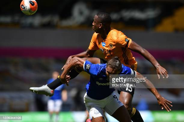 Wolverhampton Wanderers' French defender Willy Boly blocks Everton's English striker Dominic Calvert-Lewin during the English Premier League football...