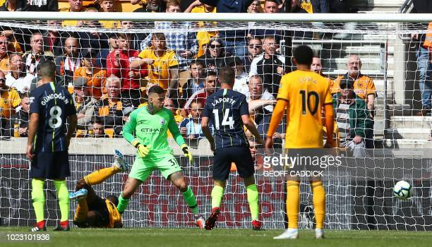 Wolverhampton Wanderers' French defender Willy Boly scores the opening goal during the English Premier League football match between Wolverhampton...