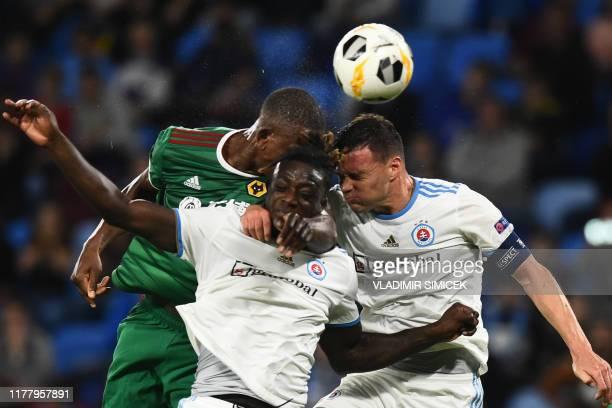 TOPSHOT Wolverhampton Wanderers' French defender Willy Boly Slovan's Dutch defender Myenty Abena and Slovan Bratislava's Bulgarian defender Vasil...