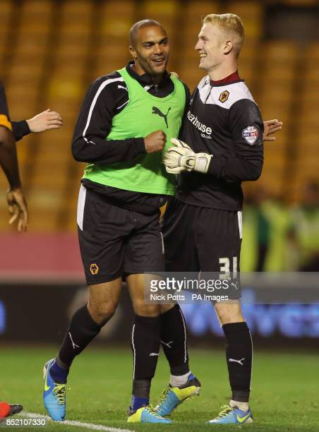 Wolverhampton Wanderers' goalkeeper Aaron McCarey celebrates after his two saves against Walsall in the penalty shoot out with fellow goalkeeper Carl...