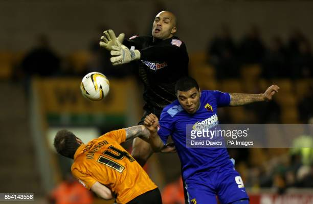 Wolverhampton Wanderers goalkeeper Carl Ikeme clears under pressure from Watford's Troy Deeney during the npower Football League Championship match...