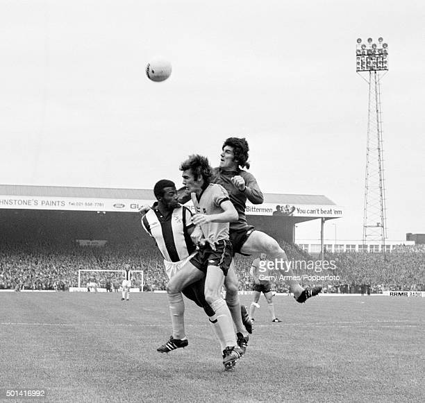 Wolverhampton Wanderers goalkeeper Phil Parkes and defender John McAlle combine to clear the ball above West Bromwich Albion striker Cyrille Regis...
