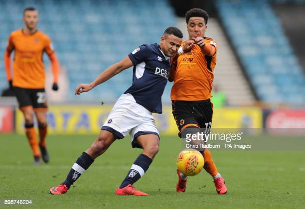 Wolverhampton Wanderers Helder Costa is held off by Millwall's James Meredith during the Sky Bet Championship match at The New Den London