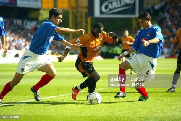 Wolverhampton Wanderers' Henri Camara and Portsmouth's Dejan Stefanovic and Boris Zivkovic