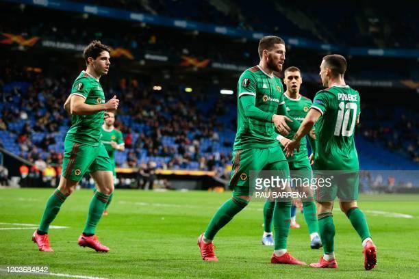 Wolverhampton Wanderers' Irish defender Matt Doherty celebrates with Wolverhampton Wanderers' Portuguese forward Daniel Podence after scoring during...