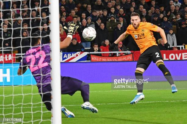 Wolverhampton Wanderers' Irish defender Matt Doherty sees his shot saved by Manchester United's Argentinian goalkeeper Sergio Romero during the FA...