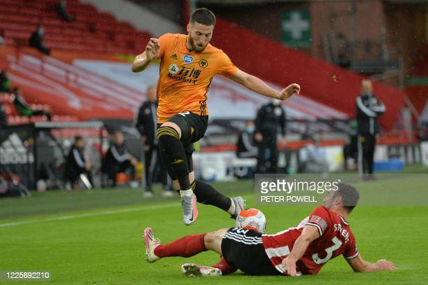 Wolverhampton Wanderers' Irish defender Matt Doherty vies with Sheffield United's Irish defender Enda Stevens during the English Premier League...