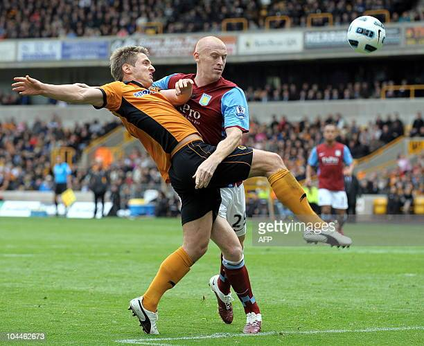 Wolverhampton Wanderers' Irish forward Kevin Doyle vies with Aston Villa's Welsh defender James Collins during the English Premier League football...