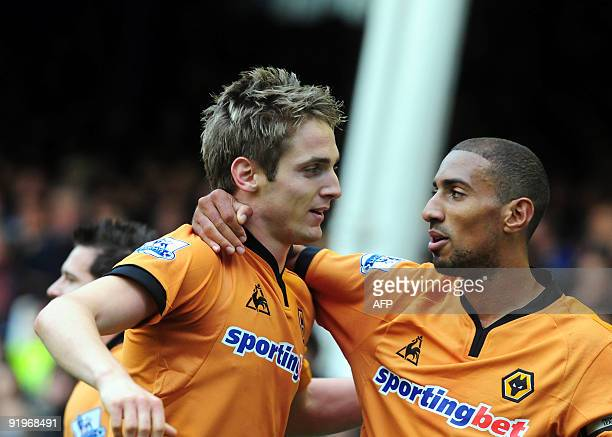Wolverhampton Wanderers' Irish striker Kevin Doyle celebrates his goal with Karl Henry during the English Premier League football match between...