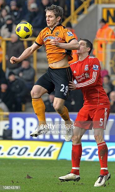 Wolverhampton Wanderers' Irish striker Kevin Doyle vies with Liverpool's Danish defender Daniel Agger during the English Premier League football...