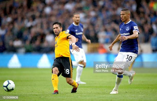 Wolverhampton Wanderers' Joao Moutinho and Everton's Richarlison during the Premier League match at Molineux Wolverhampton