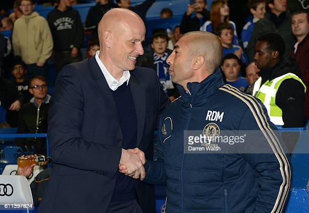 Wolverhampton Wanderers manager Staale Solbakken and Chelsea manager Roberto Di Matteo greet each other prior to kickoff