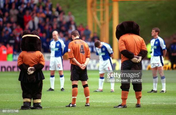 Wolverhampton Wanderers' mascots Wendy and Wolfie stand around the centre circle with the players of both teams to observe the minute's silence in...