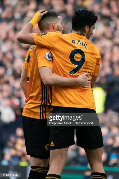Wolverhampton Wanderers' Matt Doherty celebrates scoring his side's first goal with teammate Raul Jimenez during the Premier League match between...