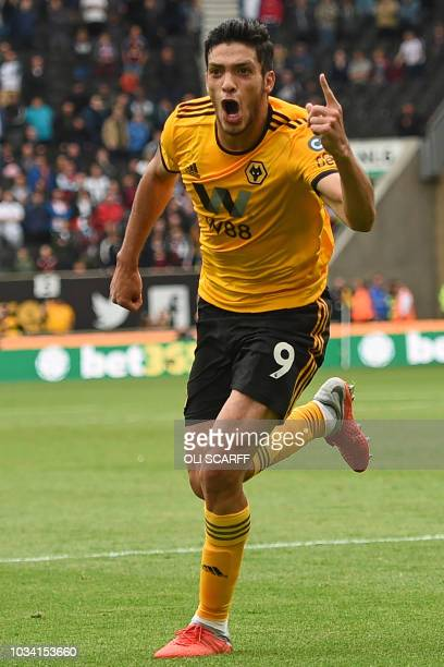 Wolverhampton Wanderers' Mexican striker Raul Jimenez celebrates after scoring the opening goal of the English Premier League football match between...