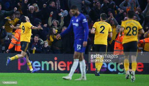 Wolverhampton Wanderers' Mexican striker Raul Jimenez celebrates scoring their first goal to equalise 11 during the English Premier League football...