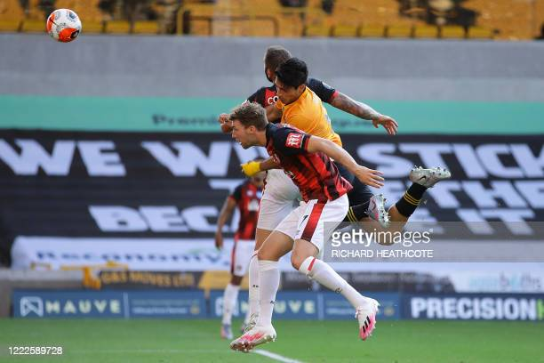 Wolverhampton Wanderers' Mexican striker Raul Jimenez heads home the opening goal under pressure from Bournemouth's English defender Jack Stacey and...