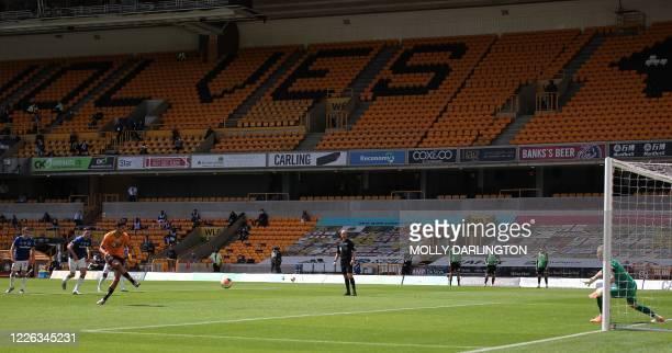 Wolverhampton Wanderers' Mexican striker Raul Jimenez scores a penalty past Everton's English goalkeeper Jordan Pickford during the English Premier...