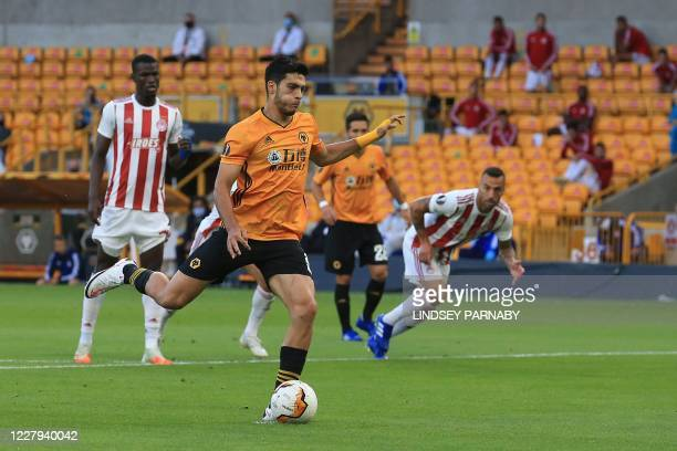 Wolverhampton Wanderers' Mexican striker Raul Jimenez shoots from the penalty spot to score the opening goal during the UEFA Europa League round of...