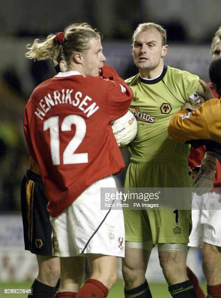 Wolverhampton Wanderers' Michael Oakes gets himself booked as he shows his anger with Kiddmerminster Harriers striker Bo Henriksen after a yellow...