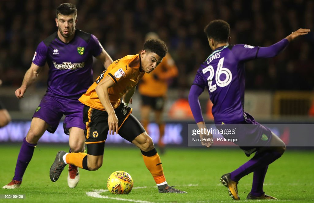 Wolverhampton Wanderers' Morgan Gibbs-White attacks Norwich City's Jamal Lewis and Norwich City's Grant Hanley (left) during the Sky Bet Championship match at Molineux, Wolverhampton.