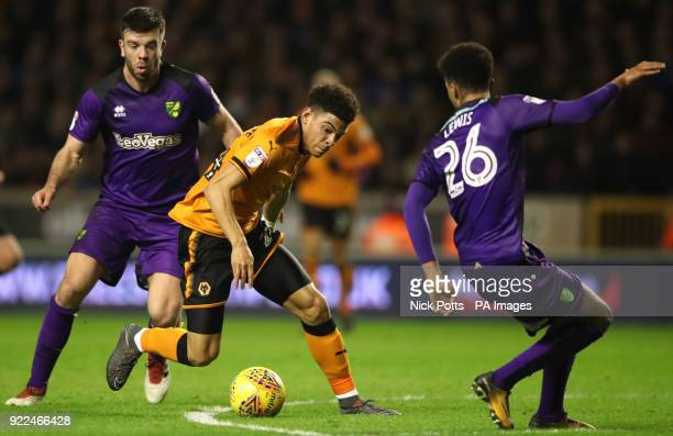 Wolverhampton Wanderers' Morgan GibbsWhite attacks Norwich City's Jamal Lewis and Norwich City's Grant Hanley during the Sky Bet Championship match...